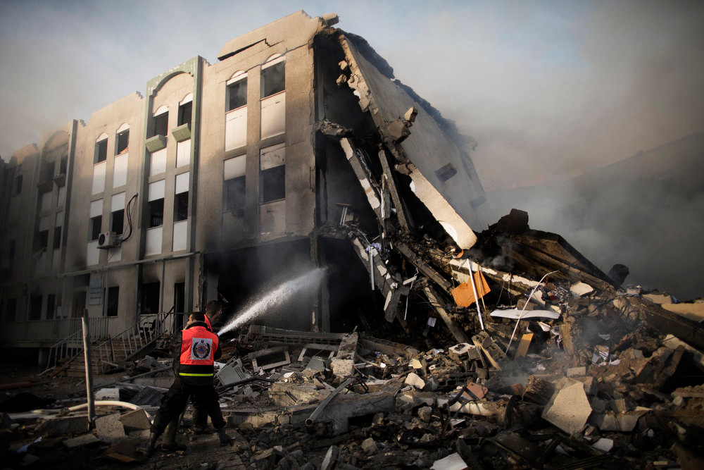 Description of . Palestinian firefighters try to extinguish a fire at the Civilian Affairs branch of the Ministry of Interior following an Israeli air raid in Gaza City on November 16, 2012. Israel was condemned by much of the Arab world while securing Western backing and pressing its biggest air assault on Gaza for years amid a wave of Palestinian short-range rocket fire. MARCO LONGARI/AFP/Getty Images