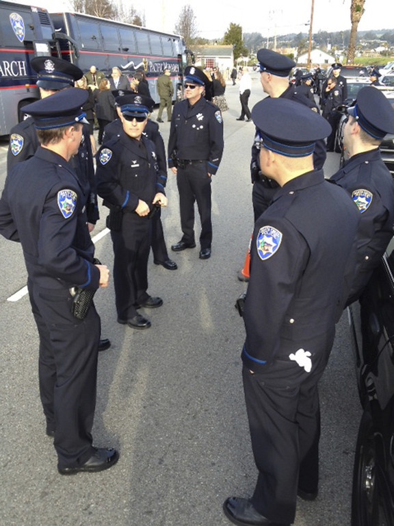 . Santa Cruz police officers gather at front of the memorial procession for their fallen comrades Sgt. Loran \'Butch\' Baker and detective Elizabeth Butler. (Dan Coyro/Sentinel)