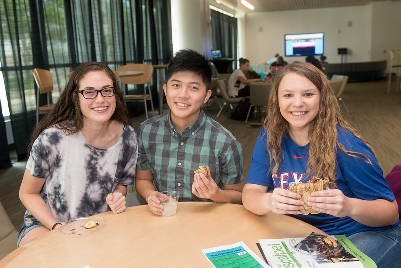 Breanna Poses (left), Brandon Phung, and Emalee Keim enjoy peanut butter and jelly sandwiches in the Tejas Lounge during the Extreme PB&J event during finals week. To see all the photos fromt this event go to: https://islanduniversity.smugmug.com/Events/Events-By-Year/2017/050317-Extreme-Peanut-Butter-and-Jelly/