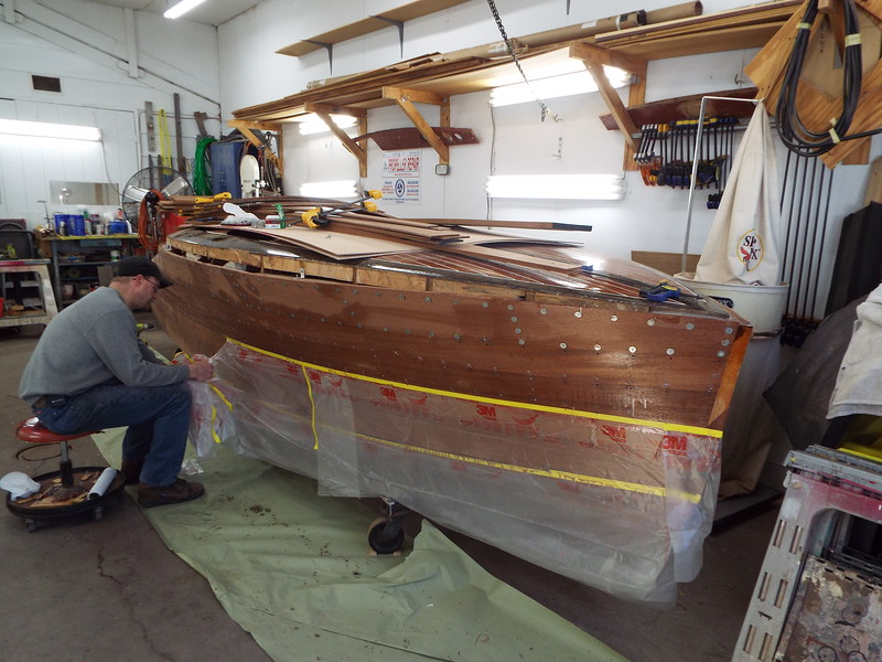 Cleaning up after the last starboard plank was installed.