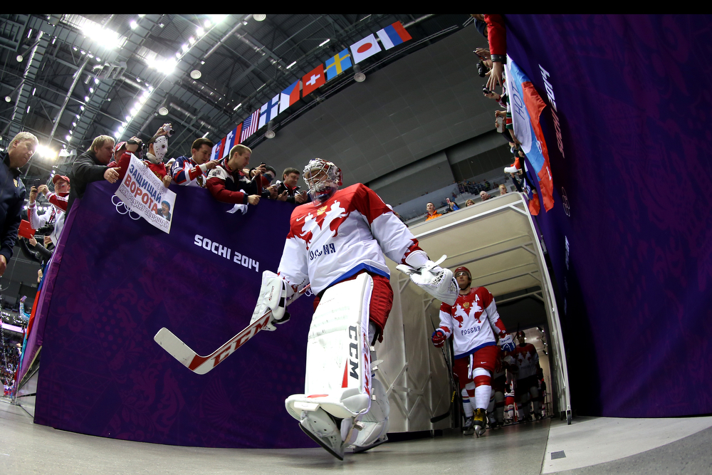 . Semyon Varlamov #1 of Russia enters the arena during the Men\'s Ice Hockey Quarterfinal Playoff on Day 12 of the 2014 Sochi Winter Olympics at Bolshoy Ice Dome on February 19, 2014 in Sochi, Russia.  (Photo by Bruce Bennett/Getty Images)