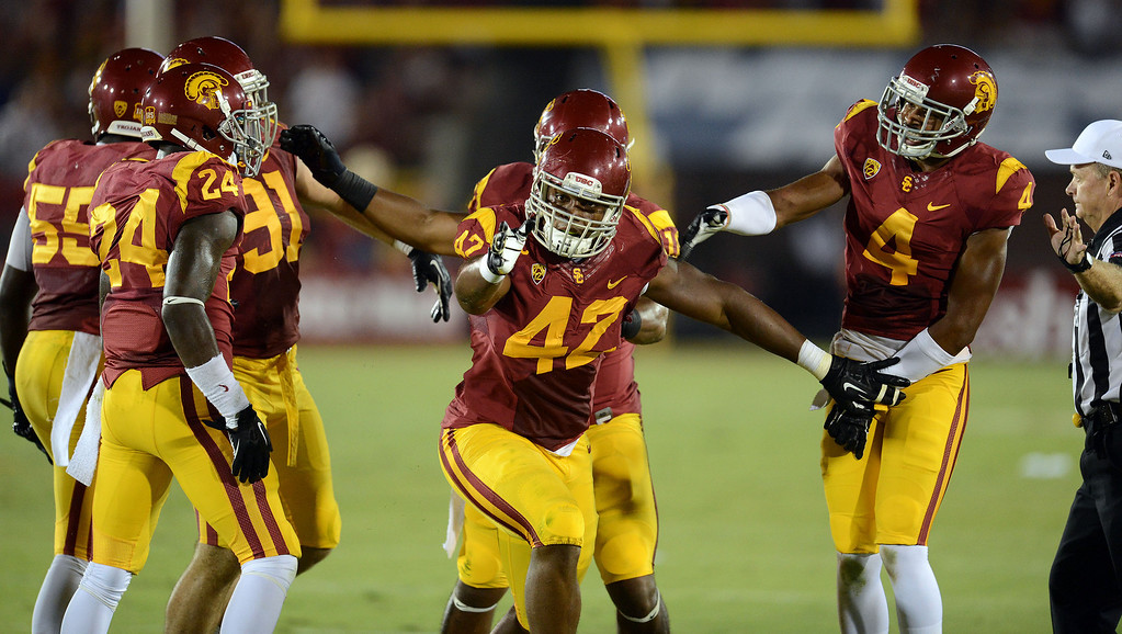 . USC\'s Devon Kennard #42 celebrates after scooping up a Washington State fumble in the 2nd quarter at the Los Angeles Memorial Coliseum  Saturday, September 7, 2013.  (Photo by Hans Gutknecht/Los Angeles Daily News)