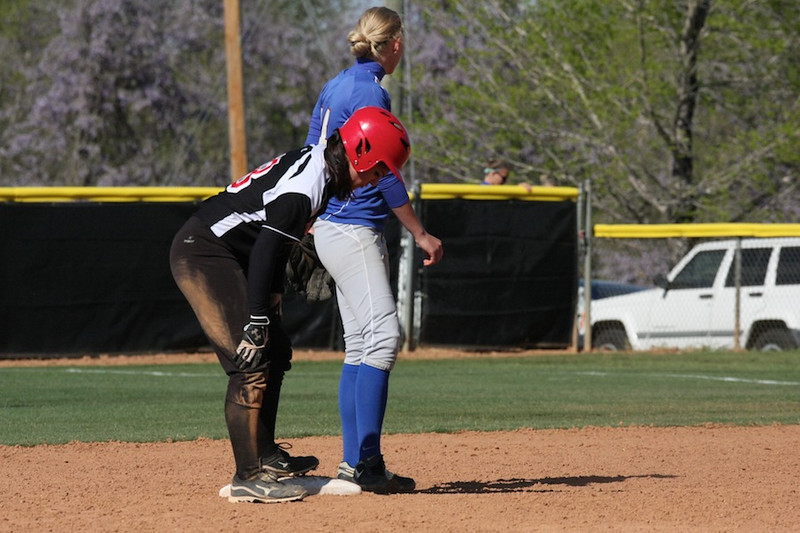 Number 18, Kelsey Witter, recovers from a slide to second.