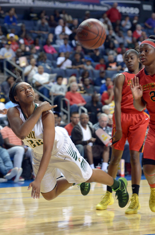 . After being fouled, Poly\'s Jada Matthews fires up a desperation shot at Citizens Business Bank Arena in Ontario, CA on Saturday, March 22, 2014. Long Beach Poly vs Etiwanda in the CIF girls open division regional final. 1st half, Photo by Scott Varley, Daily Breeze)