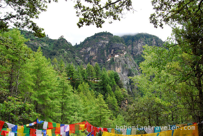 Tigers Nest Monastery with prayer flags from afar.jpg