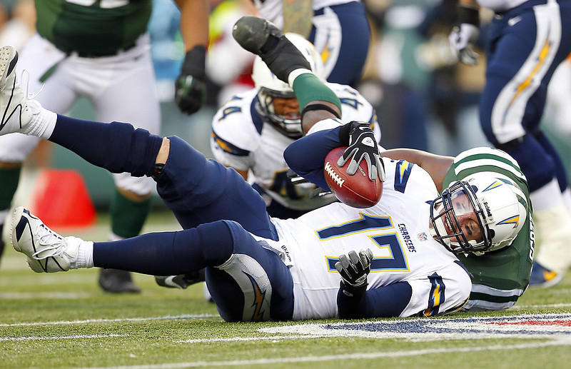 . Quarterback Philip Rivers #17 of the San Diego Chargers is sacked by Bart Scott #57 of the New York Jets during the second half at MetLife Stadium on December 23, 2012 in East Rutherford, New Jersey. The Chargers defeated the Jets 27-17. (Photo by Rich Schultz /Getty Images)