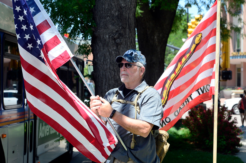 . David Kyle gets the attention of oncoming traffic on Broadway during a Second Amendment rally in Boulder on Saturday. For more photos and video go to dailycamera.com. Paul Aiken Staff Photographer