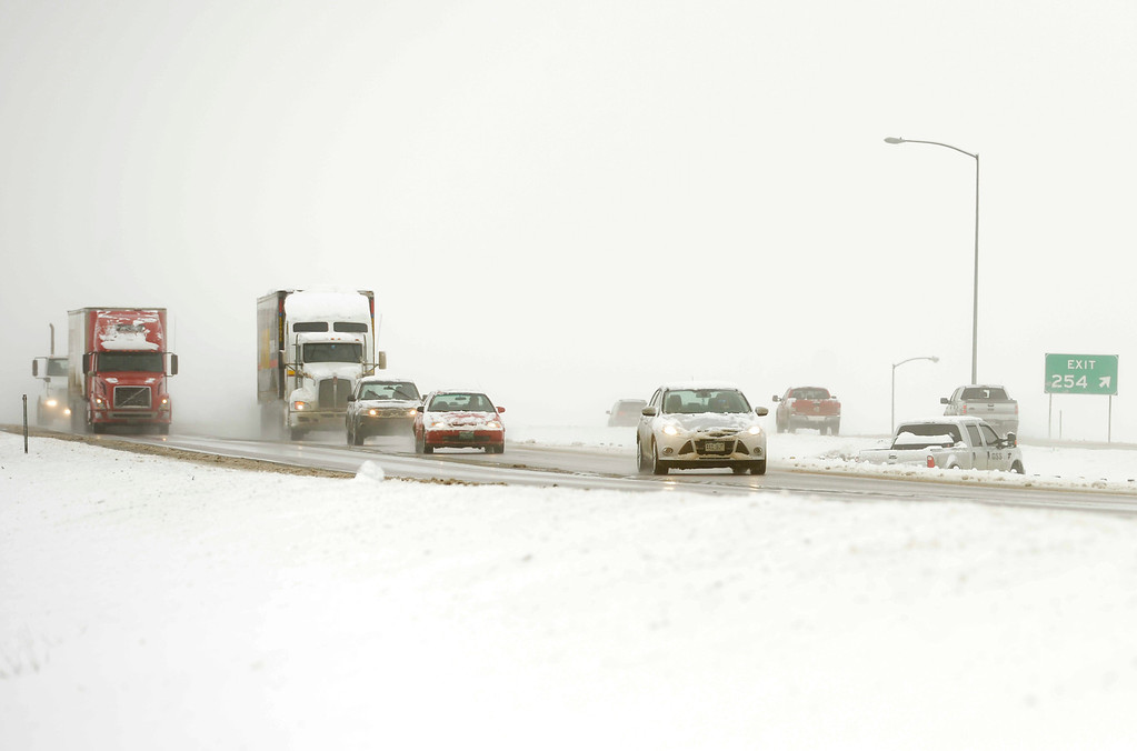 . A truck slid off Interstate 25 near Berthoud, April 16, 2013, after a spring snow storm hit northern Colorado. (Photo By RJ Sangosti/The Denver Post)
