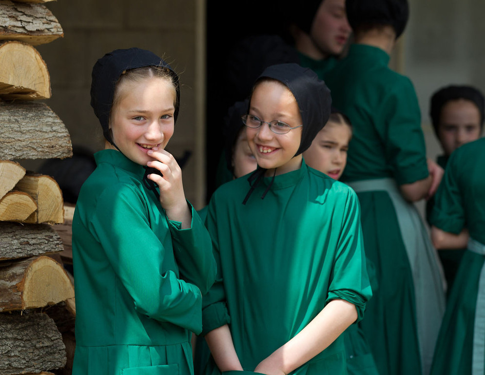 . Amish girls gather outside the school house prior to the start of their final day of class in Bergholz, Ohio on Tuesday, April 9, 2013. (AP Photo/Scott R. Galvin)