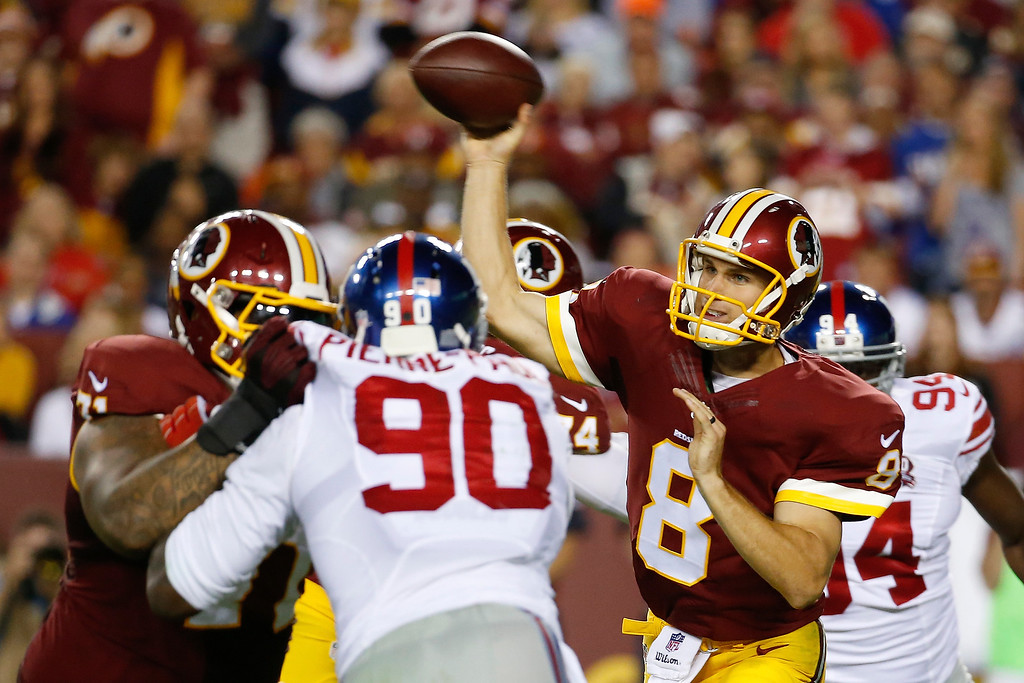 . Washington Redskins quarterback Kirk Cousins (8) throws a pass during the first half of an NFL football game against the New York Giants in Landover, Md., Thursday, Sept. 25, 2014. (AP Photo/Alex Brandon)