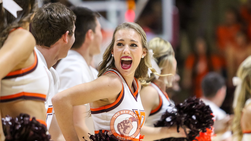 A Virginia Tech cheerleader reacts during