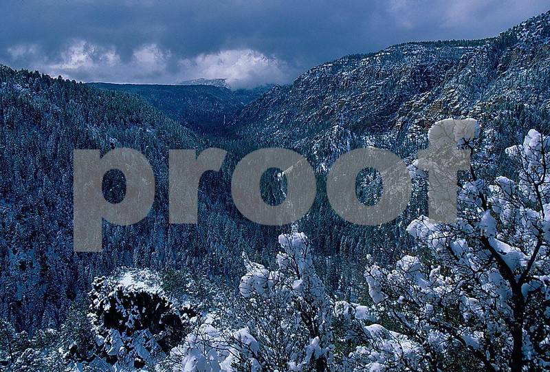 A snow covered landscape in Oak Creek Canyon on the drive south from Flagstaff to Sedona, AZ.