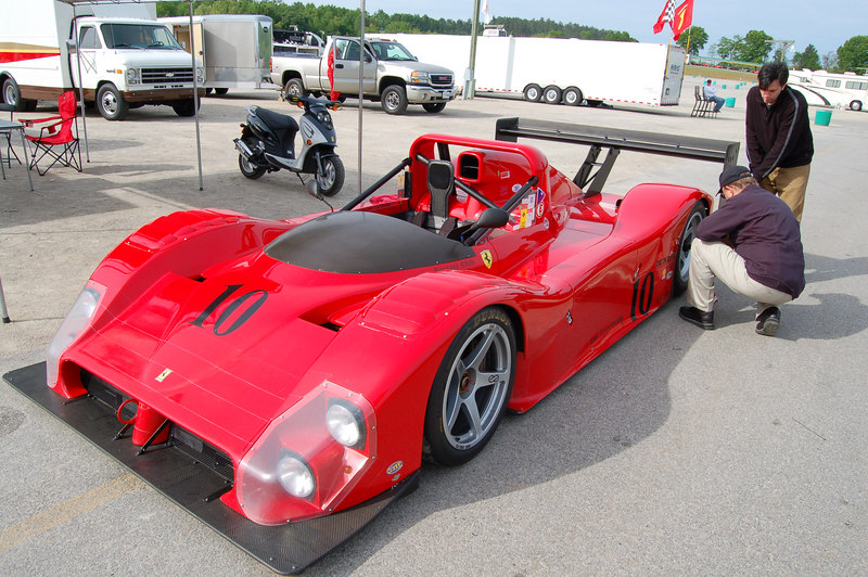 Tightening the wheel locks on a Ferrari 333SP