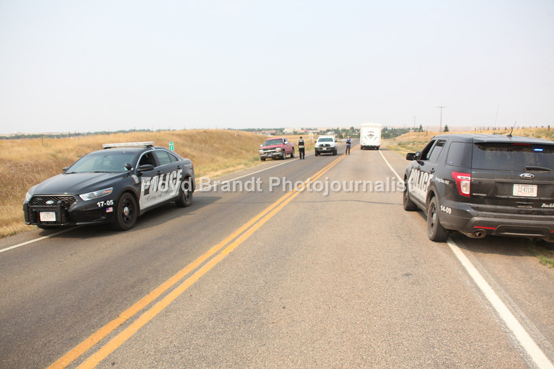 Havre Daily News/Floyd Brandt  Havre Police  closed Beaver Creek Road opened only to resident and fire fighting equipment and personal Wednesday, winds blowing from the south pushed the Left Fork Fire into Beaver Creek Park.