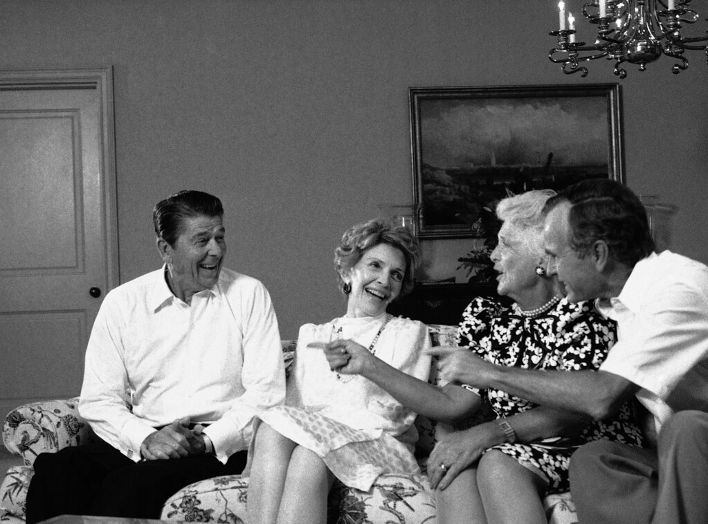 . President Reagan shares a laugh with first lady Nancy Reagan and Vice President and Mrs. George Bush at night on Wednesday, August 22, 1984 in Dallas after the Republican National Convention nominated him for a second term. (AP Photo/J. Scott Applewhite)
