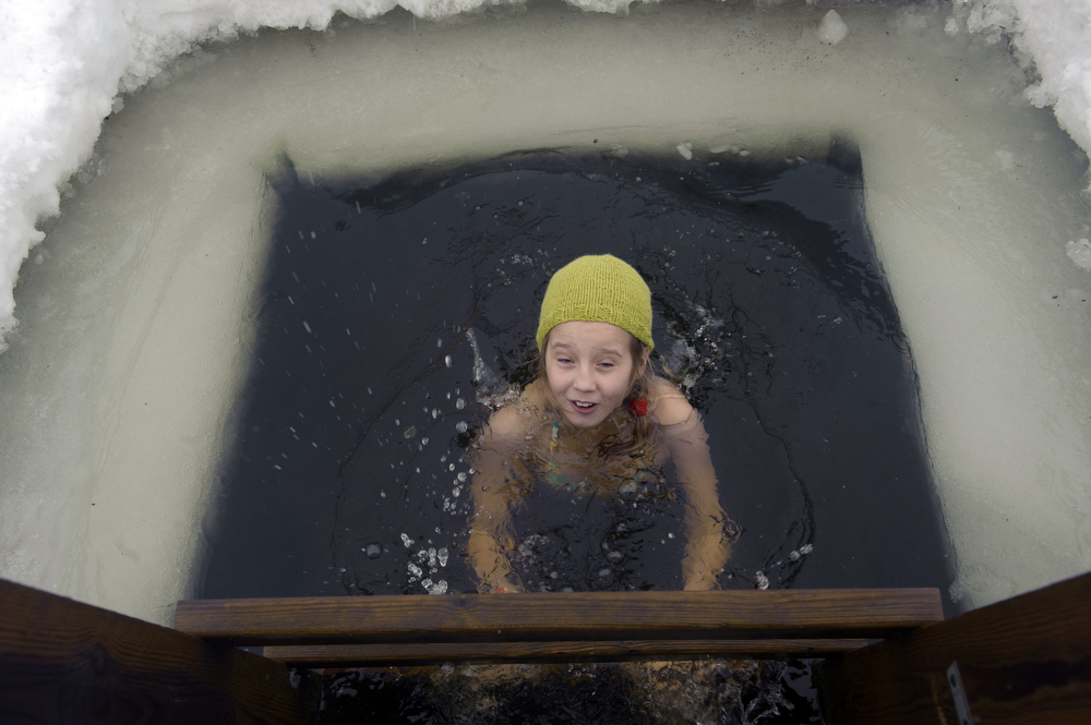 . A girl bathes in icy water as she takes part in the European Sauna Marathon in Otepaeae, southern Estonia, on February 10, 2013. Around 600 participants in 150 teams compete in the event to find out which team takes the shortest time to use 22 saunas and to jump into nine ice holes.     AFP PHOTO / RAIGO PAJULA / ESTONIA OUTRAIGO PAJULA/AFP/Getty Images