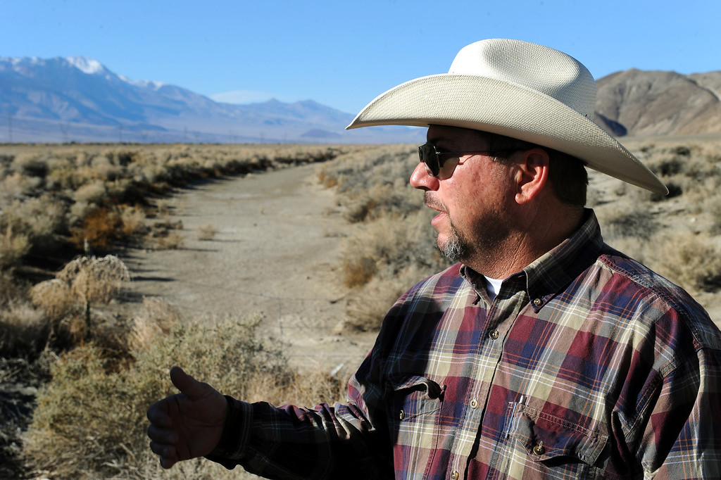 . Mark Lacey, a rancher who leases land in the Owens Valley from the DWP for his cattle business, stands by an irrigation ditch used by ranchers before the construction of the L.A. Aqueduct. (Photo by Michael Owen Baker/L.A. Daily News)