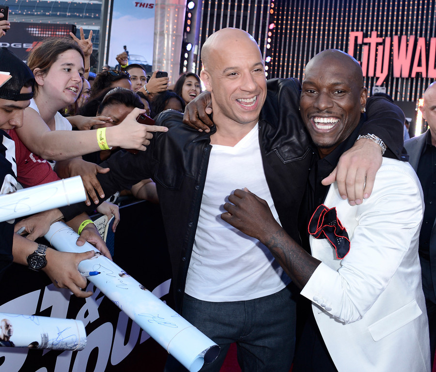 ". Actor Vin Diesel, left, and actor Tyrese Gibson embrace at the LA Premiere of the ""Fast & Furious 6\"" at the Gibson Amphitheatre on Tuesday, May 21, 2013 in Universal City, Calif. (Photo by Dan Steinberg/Invision/AP)"