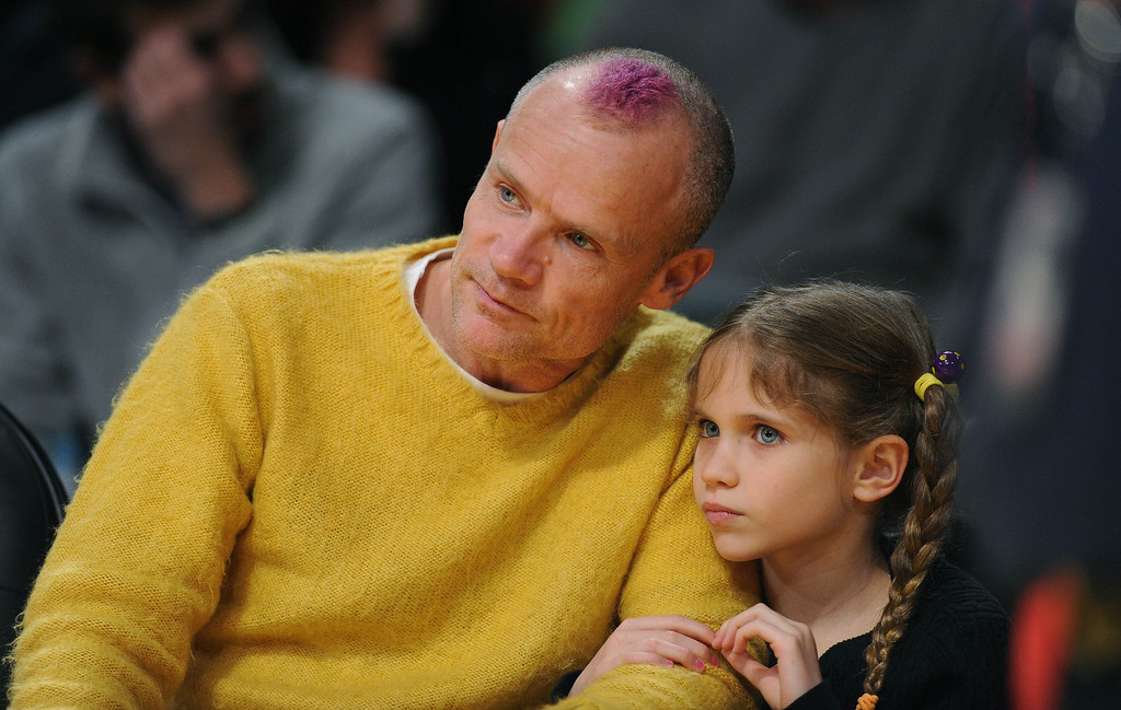 . Flea from the Red Hot Chili Peppers and daughter watch the Los Angeles Lakers host the Chicago Bulls in a NBA basketball game at Staples Center in Los Angeles, CA. on Sunday, February 9, 2014. (Photo by Sean Hiller/ Daily Breeze).