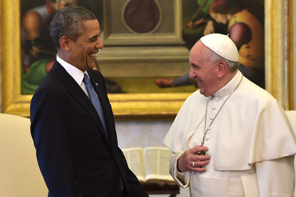 . Pope Francis and President Barack Obama share a laugh as they meet at the Vatican Thursday, March 27, 2014.  (AP Photo/Gabriel Bouys, Pool)