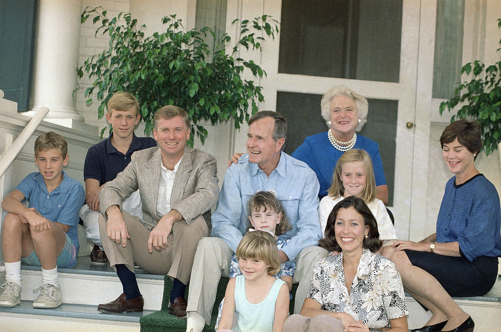 . Vice Pres. George H. W. Bush, center, poses during a photo session for photographers prior to a lunch for his running mate, Sen. Dan Quayle of Indiana, third from right, and family at the vice presidents residence, Sunday, Sept. 11, 1988, Washington, D.C. From left are: Quayles son, Ben and Tucker; Quayle; Bush; Bushs twin granddaughters, Barbara and Jenna Bush; Barbara Bush; Quayles daughter, Carrin and wife, Marilyn, and Bushs daughter-in-law, Laura Bush. (AP Photo/Charles Tasnadi)