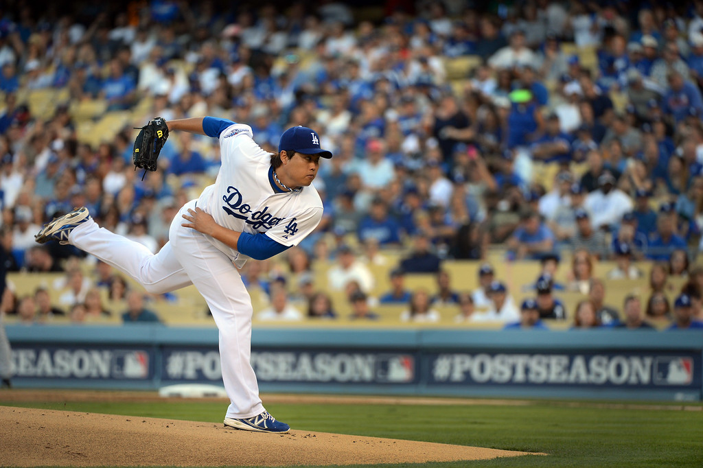 . Los Angeles Dodgers pitcher Hyun-Jin Ryu delivers a pitch during game 3 of the NLDS at Dodger Stadium Sunday, October 6, 2013. (Photo by David Crane/Los Angeles Daily News)