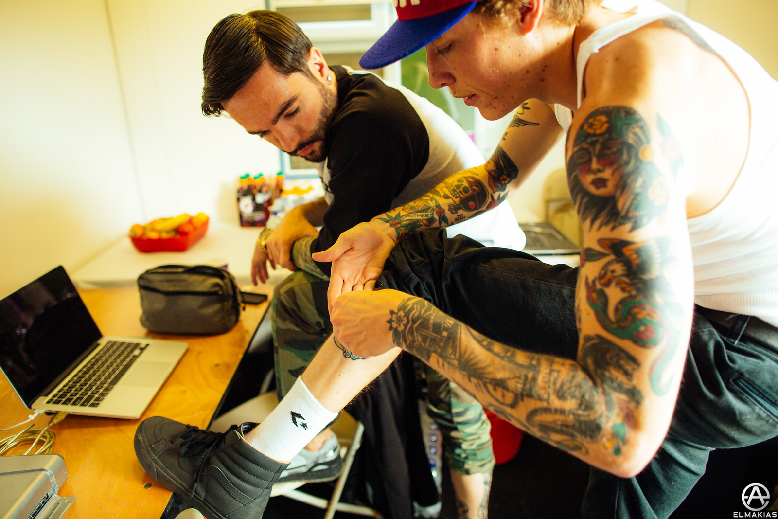 Jeremy McKinnon of A Day To Remember and Parker Cannon of The Story So Far talking about taking care of a tattoo or something.... backstage at Reading Festival
