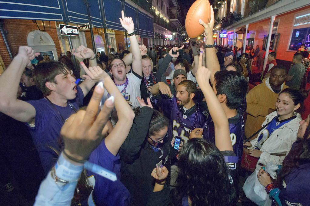 . Baltimore Ravens fans celebrate the team\'s victory as fans from the Ravens and San Francisco 49ers NFL football teams pack the French Quarter on Bourbon Street for Super Bowl XLVII near the Royal Sonesta Hotel in New Orleans, Sunday, Feb. 3, 2013. (AP Photo/Matthew Hinton)