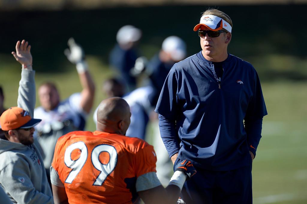 . Denver Broncos defensive coach/interim coach Jack Del Rio talks with Denver Broncos defensive tackle Kevin Vickerson (99) before practice November 20, 2013 at Dove Valley (Photo by John Leyba/The Denver Post)