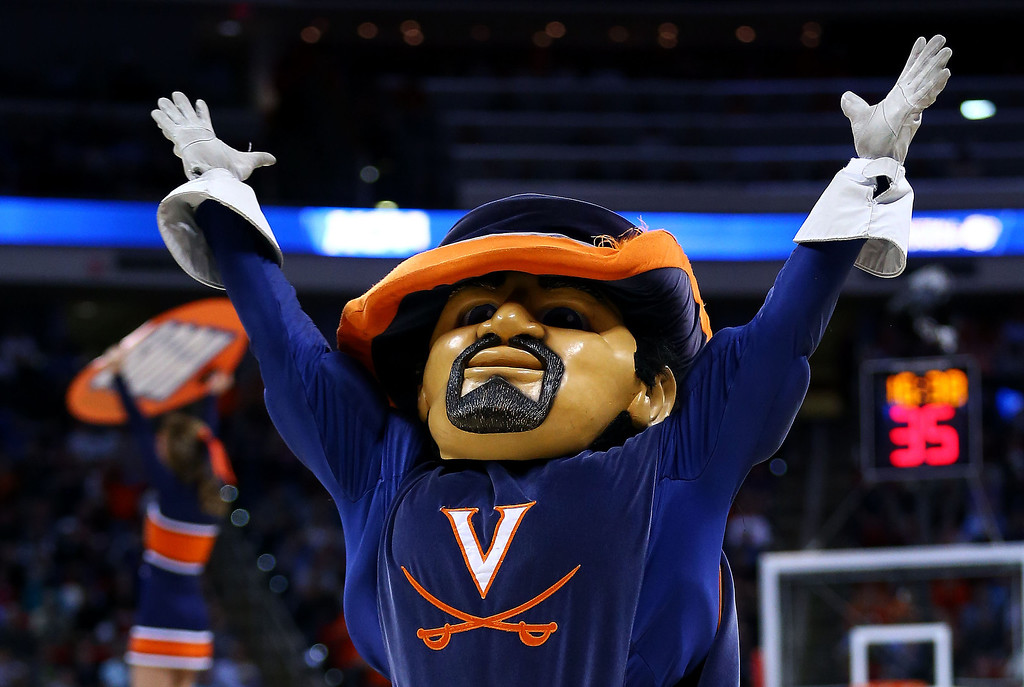 . The Virginia Cavaliers mascot, CavMan, performs in their game against the Coastal Carolina Chanticleers during the Second Round of the 2014 NCAA Basketball Tournament at PNC Arena on March 21, 2014 in Raleigh, North Carolina.  (Photo by Streeter Lecka/Getty Images)