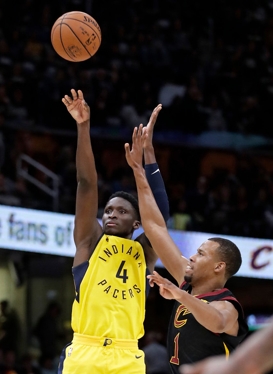 . Indiana Pacers\' Victor Oladipo (4) shoots against Cleveland Cavaliers\' Rodney Hood (1) in the second half of Game 1 of an NBA basketball first-round playoff series, Sunday, April 15, 2018, in Cleveland. (AP Photo/Tony Dejak)