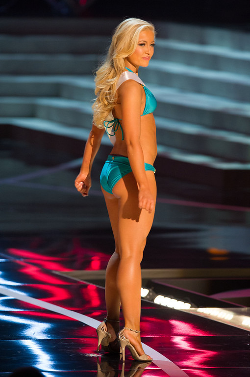 . In this photo provided by the Miss Universe Organization,  Miss Idaho USA 2013, Marissa Wickland,  competes in her swimsuit during the  2013 Miss USA Competition Preliminary Show in Las Vegas on Wednesday June 12, 2013.   She will compete for the title of Miss USA 2013 and the coveted Miss USA Diamond Nexus Crown on June 16, 2013.  (AP Photo/Miss Universe Organization, Darren Decker)