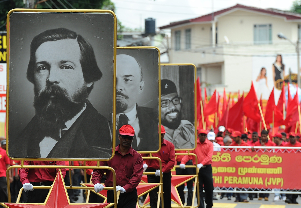. Portraits (from L-R) of German philosopher and social scientist Friedrich Engels, Russian communist revolutionary Vladimir Lenin, and Sri Lanka\'s Marxist JVP leader Rohana Wijeweera are pictured as supporters of the JVP, also known as the People\'s Liberation Front, participate in a Labour Day demonstration in Colombo on May 1, 2014. Sri Lankan workers are marking International Labour Day which falls on May 1. (LAKRUWAN WANNIARACHCHI/AFP/Getty Images)