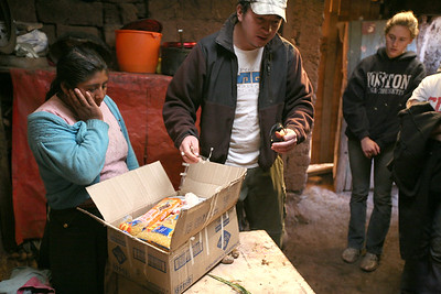 MISKIUNO, CUSCO, PERU - Home visit and delivery of food care package.
