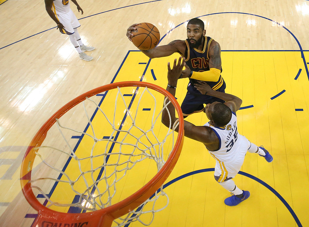 . Cleveland Cavaliers guard Kyrie Irving, top, shoots against Golden State Warriors forward Kevin Durant during the second half of Game 1 of basketball\'s NBA Finals in Oakland, Calif., Thursday, June 1, 2017. (Ezra Shaw/Pool Photo via AP)