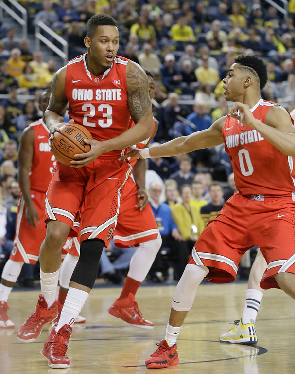 . Ohio State center Amir Williams (23) pulls down a rebound next to Ohio State guard D\'Angelo Russell (0) during the first half of an NCAA college basketball game against Michigan, Sunday, Feb. 22, 2015 in Ann Arbor, Mich. (AP Photo/Carlos Osorio)