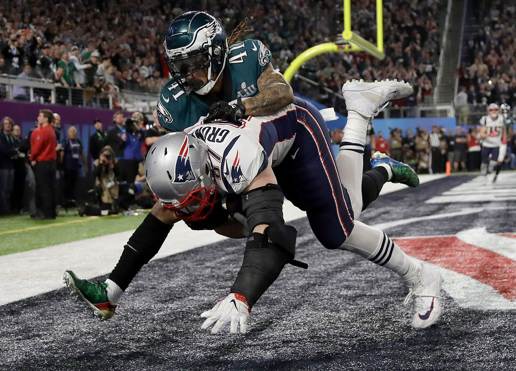 . New England Patriots\' Rob Gronkowski, bottom, catches a touchdown pass in front of Philadelphia Eagles\' Ronald Darby during the second half of the NFL Super Bowl 52 football game Sunday, Feb. 4, 2018, in Minneapolis. (AP Photo/Matt Slocum)
