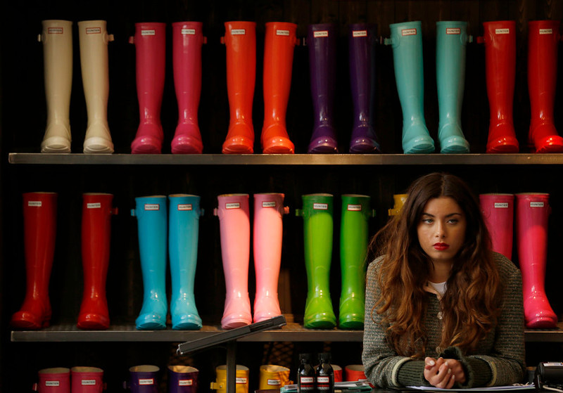 . A stallholder sells wellington boots at the Chelsea Flower Show in London May 21, 2013. REUTERS/Luke MacGregor