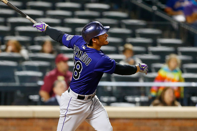 . Nolan Arenado #28 of the Colorado Rockies follows through on an eighth inning home run against the New York Mets at Citi Field on September 8, 2014 in the Flushing neighborhood of the Queens borough of New York City.  (Photo by Jim McIsaac/Getty Images)