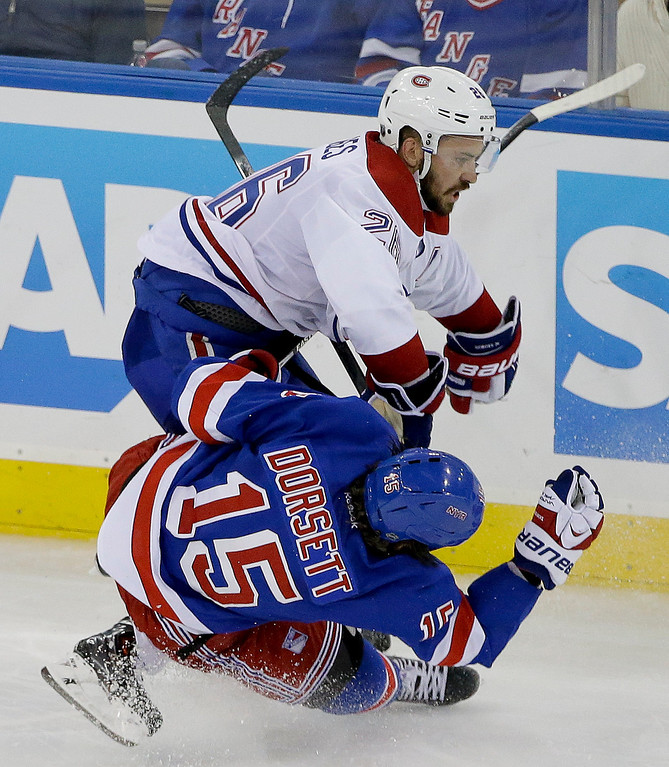 . Montreal Canadiens defenseman Josh Gorges (26) collides with New York Rangers right wing Derek Dorsett (15) during the third period in Game 6 of the NHL hockey Stanley Cup playoffs Eastern Conference finals, Thursday, May 29, 2014, in New York. (AP Photo/Frank Franklin II)