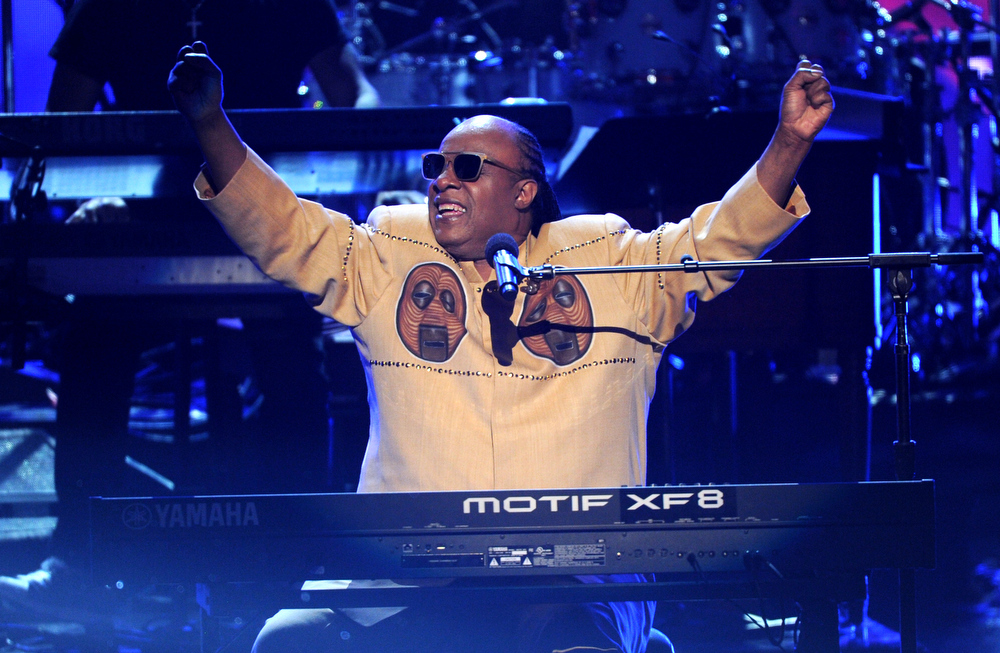 Description of . Stevie Wonder performs onstage at the BET Awards at the Nokia Theatre on Sunday, June 30, 2013, in Los Angeles. (Photo by Frank Micelotta/Invision/AP)