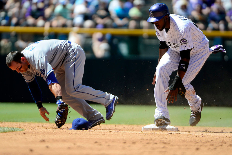 . Colorado Rockies center fielder Dexter Fowler (24) gets forced out by Los Angeles Dodgers second baseman Nick Punto (7) during action in Denver. The Colorado Rockies hosted the Los Angeles Dodgers at Coors Field. (Photo by AAron Ontiveroz/The Denver Post)