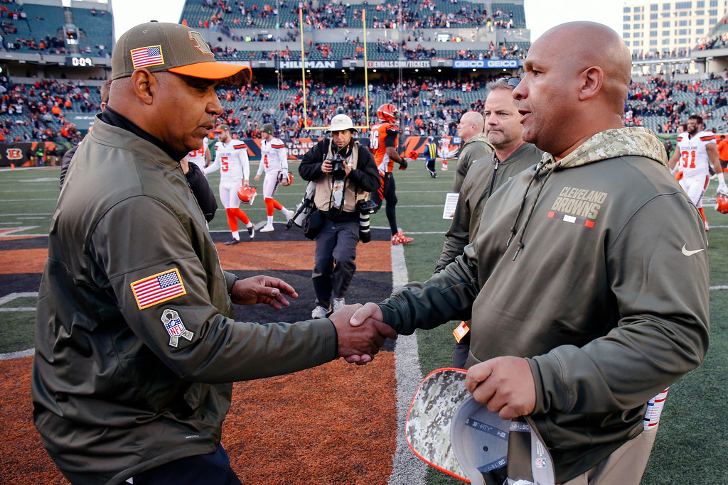 . Cincinnati Bengals head coach Marvin Lewis, left, and Cleveland Browns head coach Hue Jackson meet on the field after an NFL football game, Sunday, Nov. 26, 2017, in Cincinnati. (AP Photo/Gary Landers)
