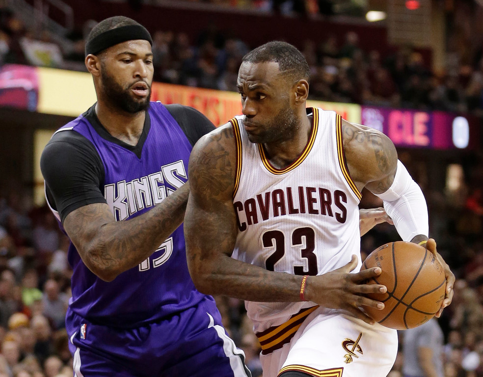 . Cleveland Cavaliers\' LeBron James, right, drives past Sacramento Kings\' DeMarcus Cousins (15) in the first half of an NBA basketball game Monday, Feb. 8, 2016, in Cleveland. (AP Photo/Tony Dejak)