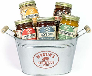 a bucket filled with multiple bbq sauces