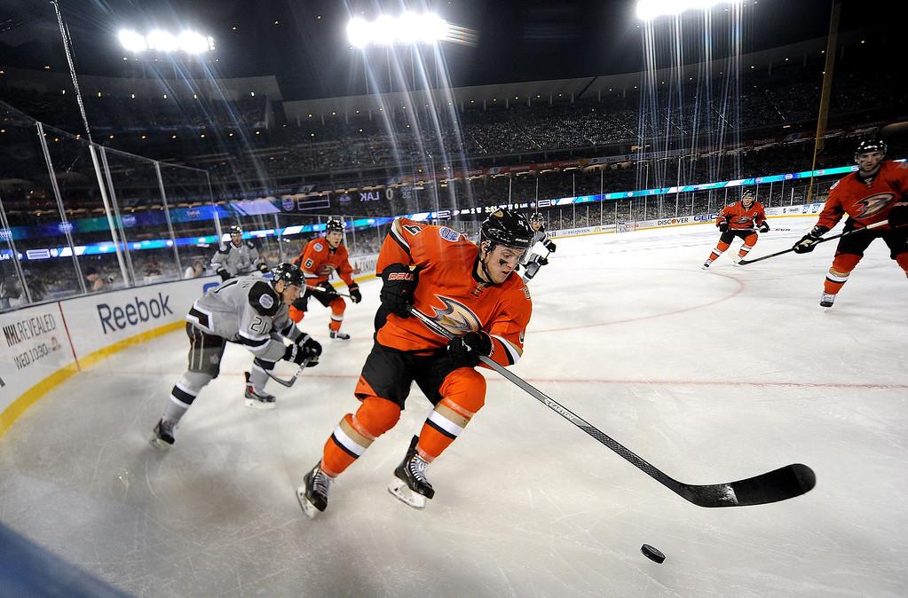 . Anaheim Ducks defenseman Cam Fowler (4) controls the puck past Los Angeles Kings right wing Matt Frattin (21) in the third period of the inaugural NHL Stadium Series game at Dodger Stadium in Los Angeles on Saturday, Jan. 25, 2014. Anaheim Ducks won 3-0. (Keith Birmingham Pasadena Star-News)