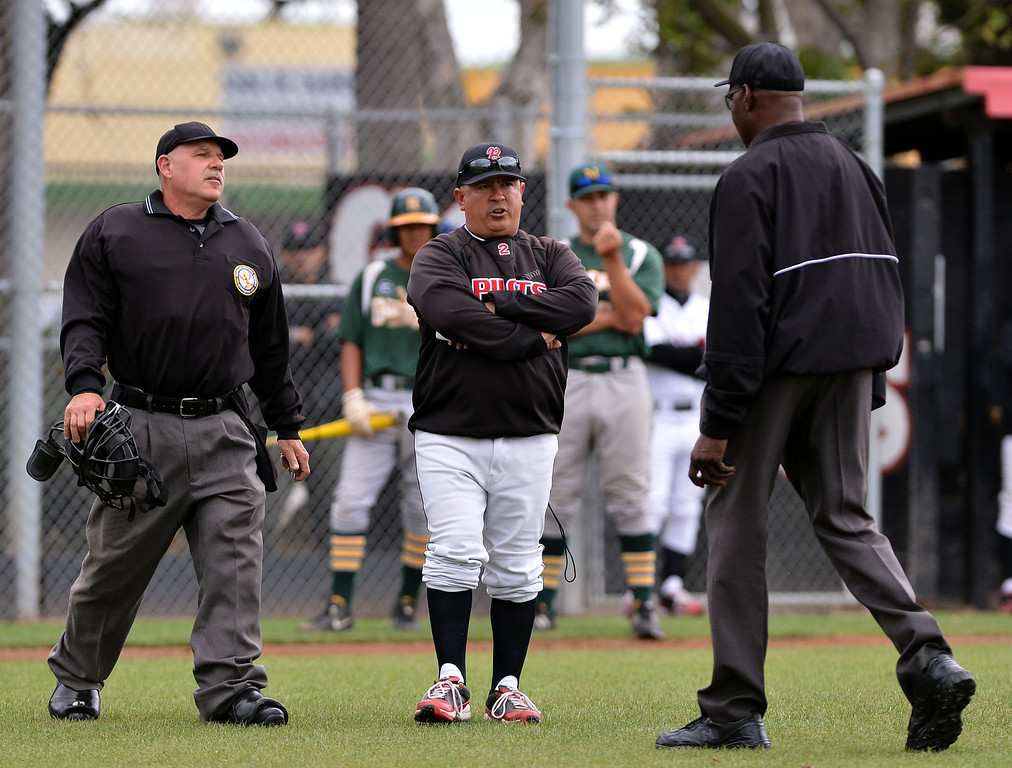 . 0507_SPT_TDB-L-NARB-BANN--20130506-- Photo: Robert Casillas / LANG     Bannning defeated visiting Narbonne 8-2 to clinch share of Marine League baseball title. Banning Coach John Gonzalez has words with umpires.