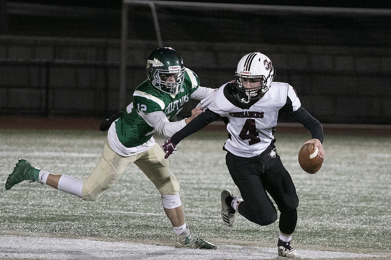 Nashoba Regional High School football hosted Groton Dunstable Regional high School on Friday night, Nov. 15, 2019. NRHS's #12 James Borsari gets a hold of GDRHS's #4 Kyle Plausse. SENTINEL & ENTERPRISE/JOHN LOVE