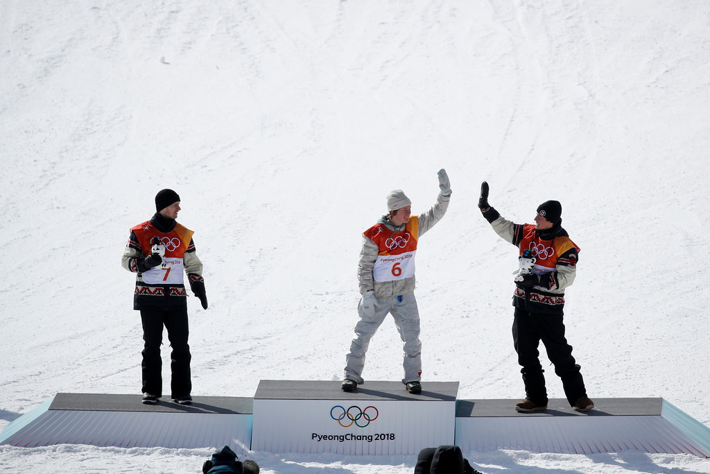 . Gold medal winner Red Gerard, of the United States, center, celebrates with bronze medal winner Mark McMorris, right, of Canada, and silver medal winner Max Parrot, of Canada, after the men\'s slopestyle final at Phoenix Snow Park at the 2018 Winter Olympics in Pyeongchang, South Korea, Sunday, Feb. 11, 2018. (AP Photo/Jae C. Hong)