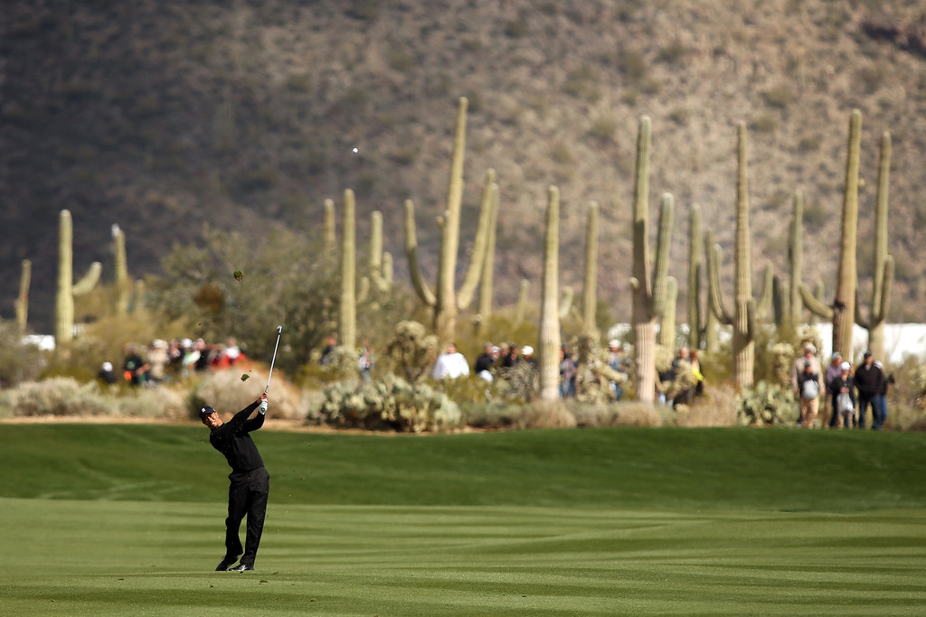 . MARANA, AZ - FEBRUARY 21:  Tiger Woods hits a shot from the fairway on the first hole during the first round of the World Golf Championships - Accenture Match Play at the Golf Club at Dove Mountain on February 21, 2013 in Marana, Arizona. Round one play was suspended on February 20 due to inclimate weather and is scheduled to be continued today.  (Photo by Darren Carroll/Getty Images)
